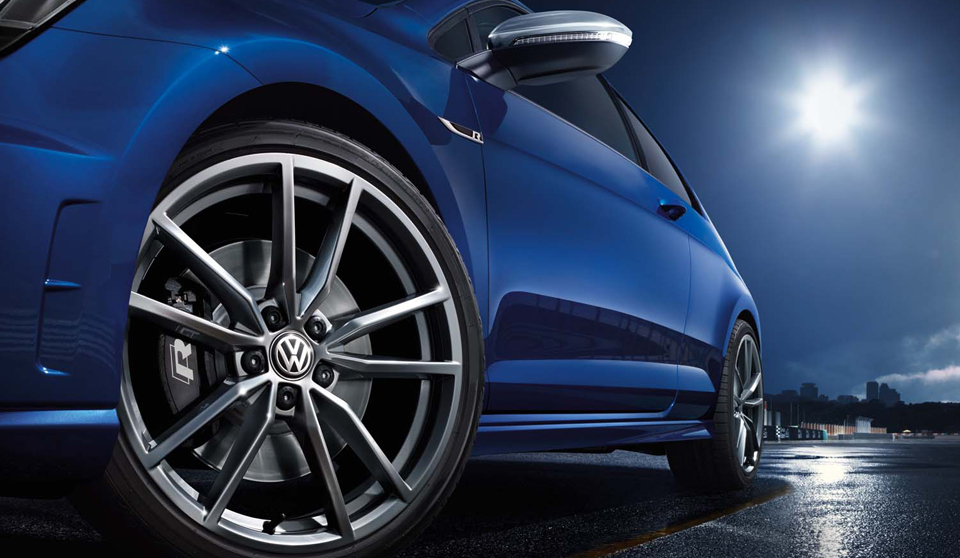 Blue Volkswagen Golf GTI VII exterior view front left wheel large