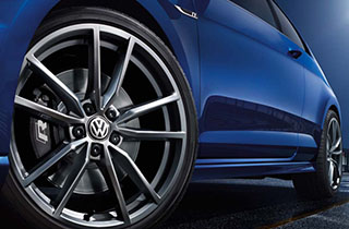 Blue Volkswagen Golf GTI VII exterior view front left wheel large thumbnail