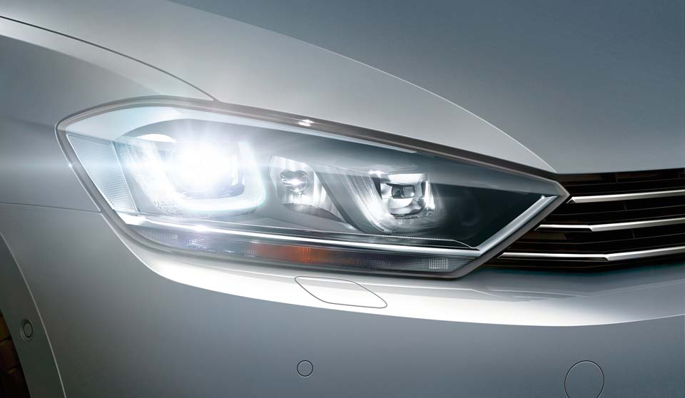 Silver Volkswagen Golf SV exterior view right headlamp large
