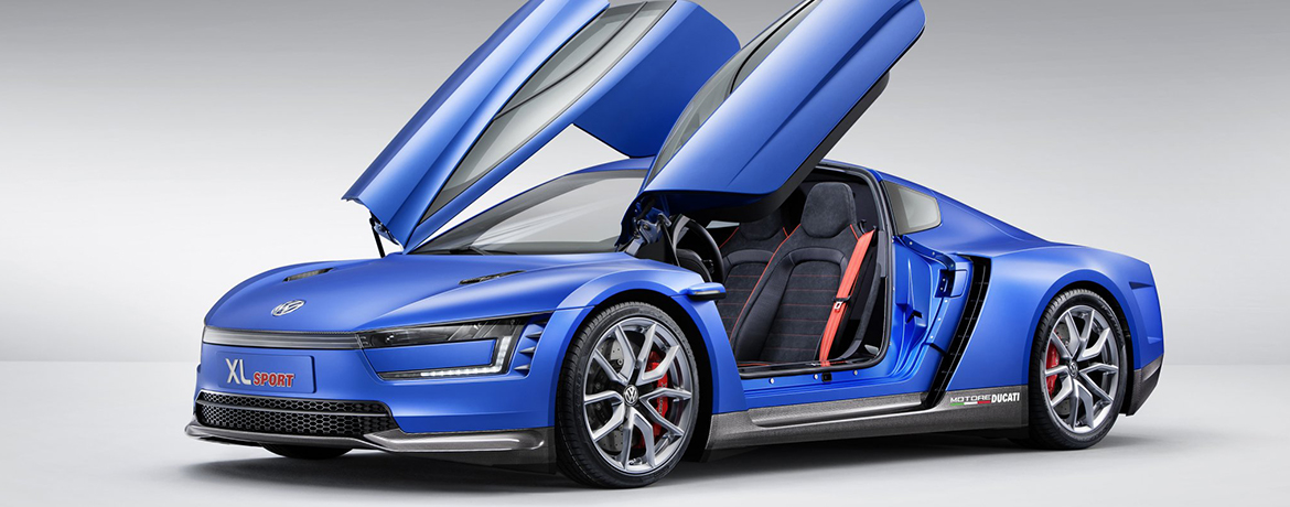 a blue Volkswagen XL1 Sport with the doors up