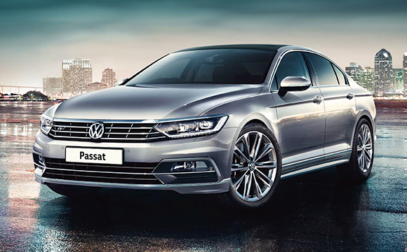 A Volkswagen Passat, with a city background.