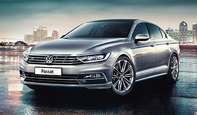A Passat photographed with a city skyline in the background.