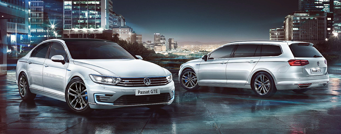 Two Passat GTEs photographed with a city skyline as a backdrop.