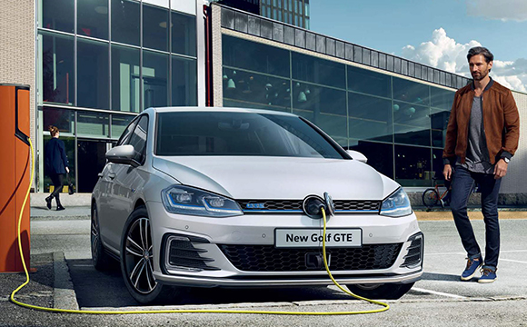 A new Golf GTE being charged with electricity.