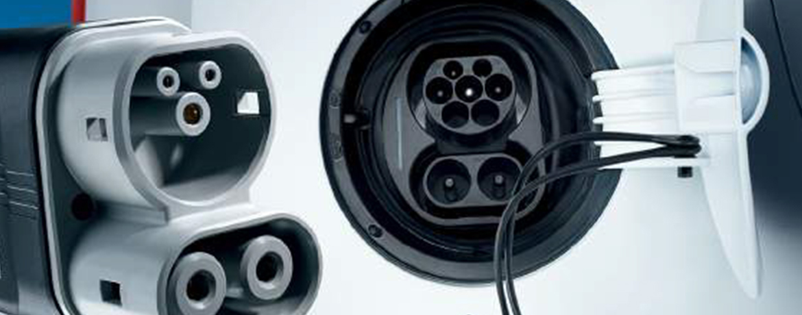 A close up of a car's electrical charging plug.