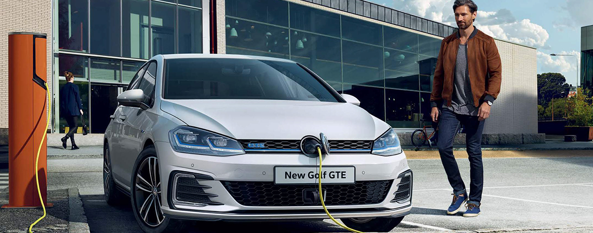A new Golf GTE being charged at an outdoor electrical charge point.