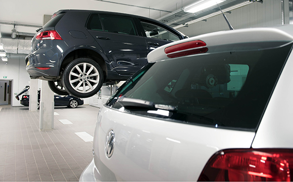 Cars being worked on at a Volkswagen service centre.