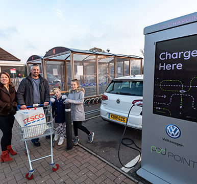 Family at a Tesco charge point