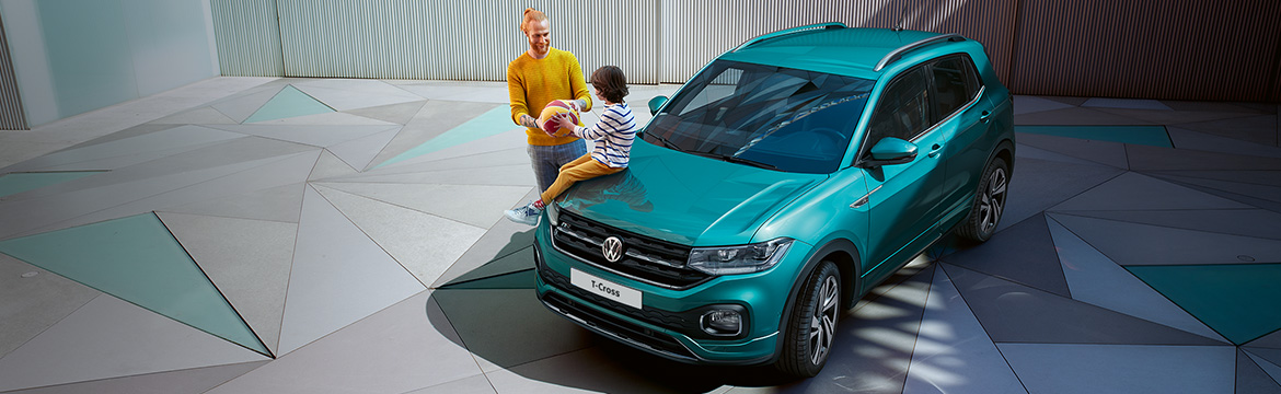 Shot of father and child by their T-Cross