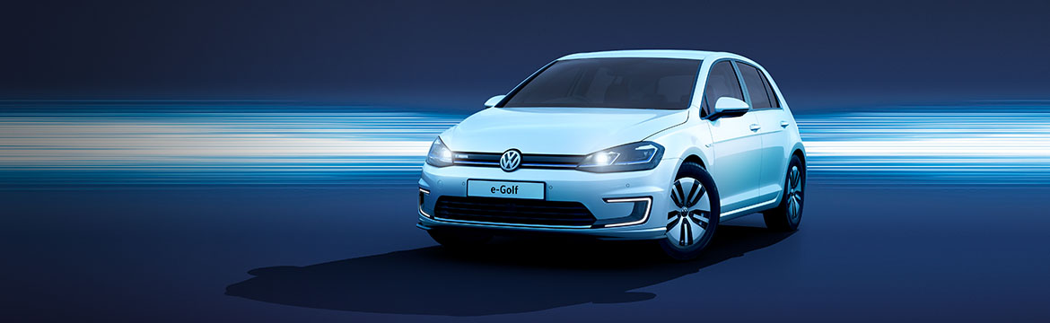 An e-Golf in front of a blue background