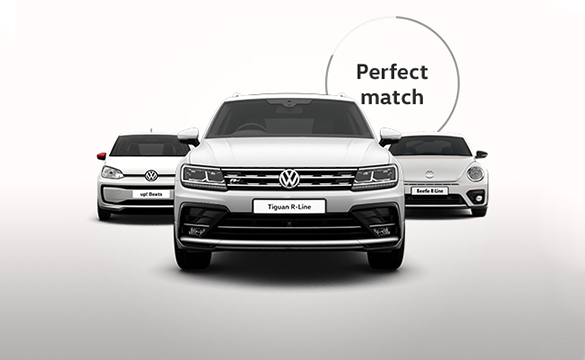 Three Volkswagen cars facing the camera: up! Beats, Tiguan R-Line and Beetle R-Line