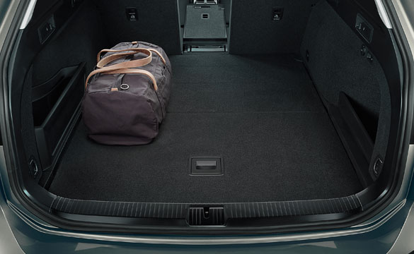 Shot of the boot compartment of the Passat Estate with a bag for scale