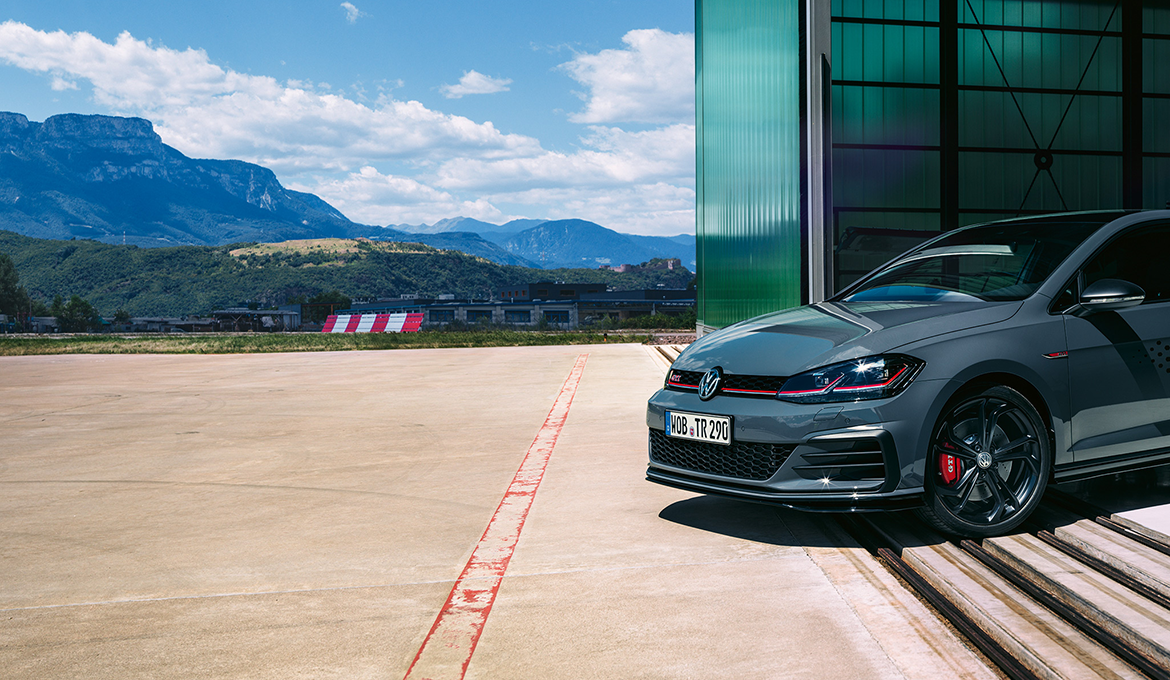 The Golf GTI TCR emerging from a hangar