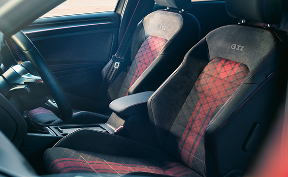 The interior seats and upholstery of the Golf GTI TCR with red pattern and suede