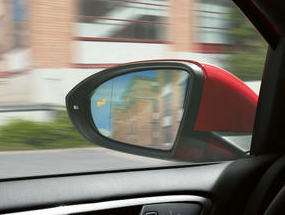 A side mirror of a car indicating a blind spot