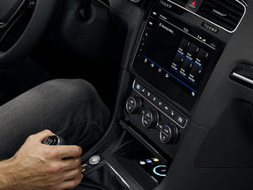 The interior of the Golf GTI showing someone driving while being able to speak to the car's applications
