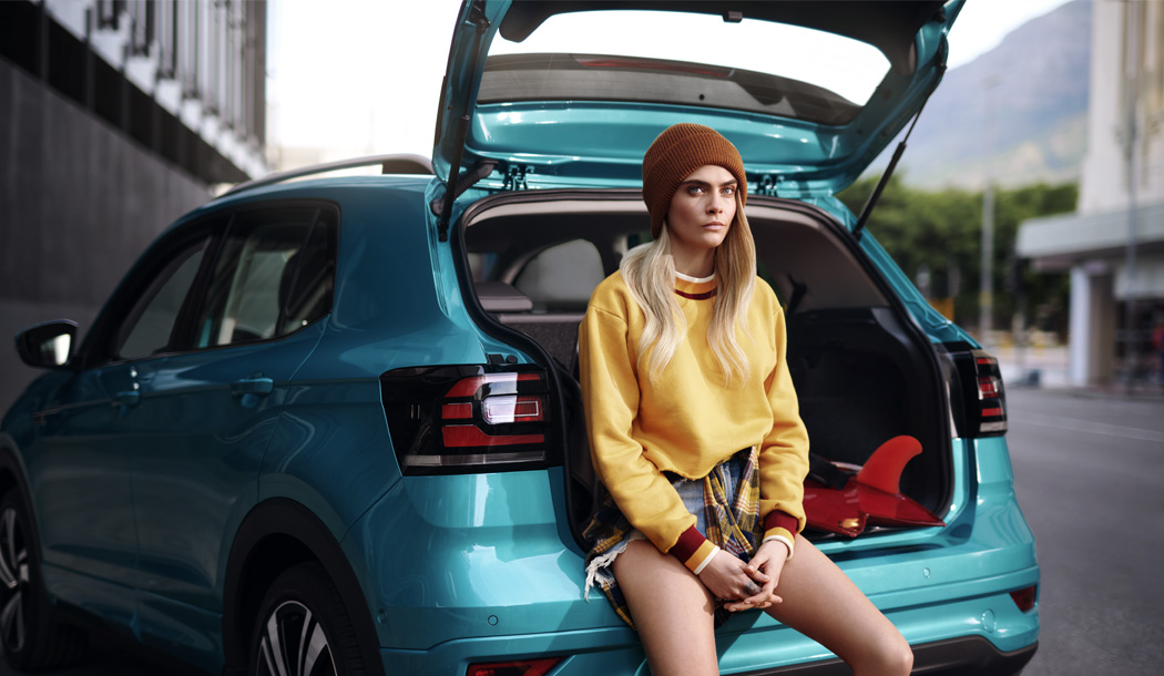 Cara Delevingne sitting in the boot of the new T-Cross.