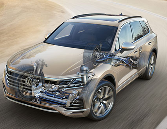 Touareg taking a corner with cutaway showing interior technology