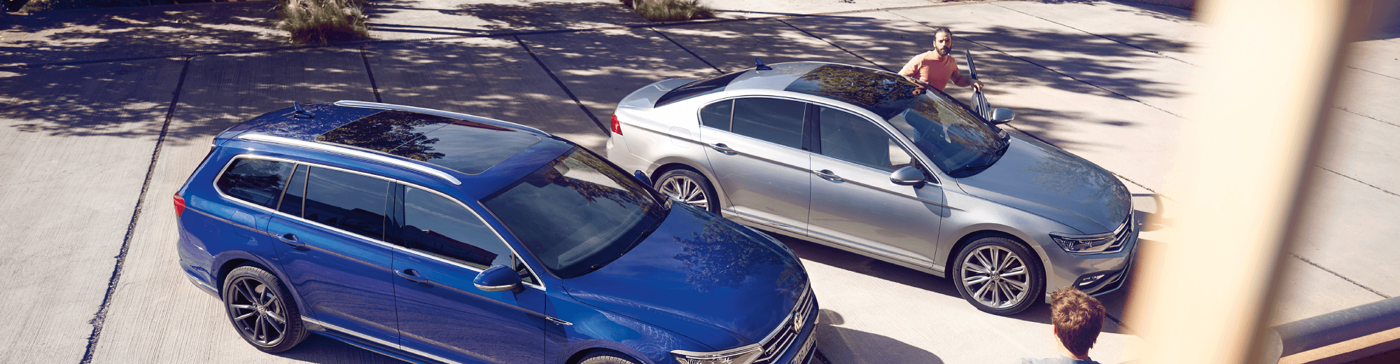Two people prepare to depart in the New Passat and New Passat Alltrack