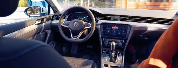 The interior of a Passat GTE with blue lining on the seats and specified dashboard for a hybrid car