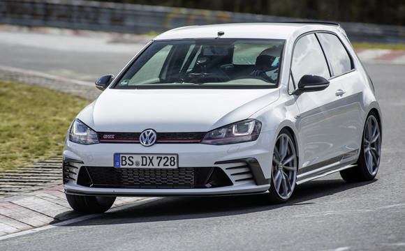White Golf GTI on the track