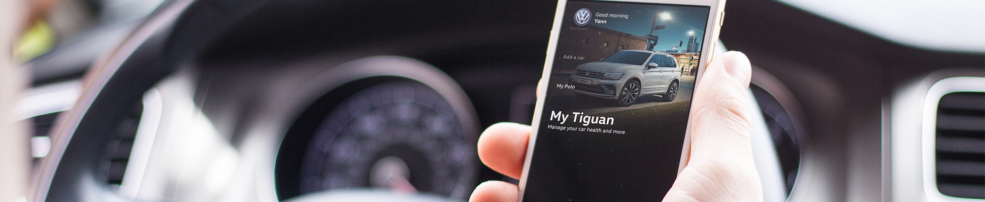 Someone using mobile phone with the My Tiguan screen showing on the app