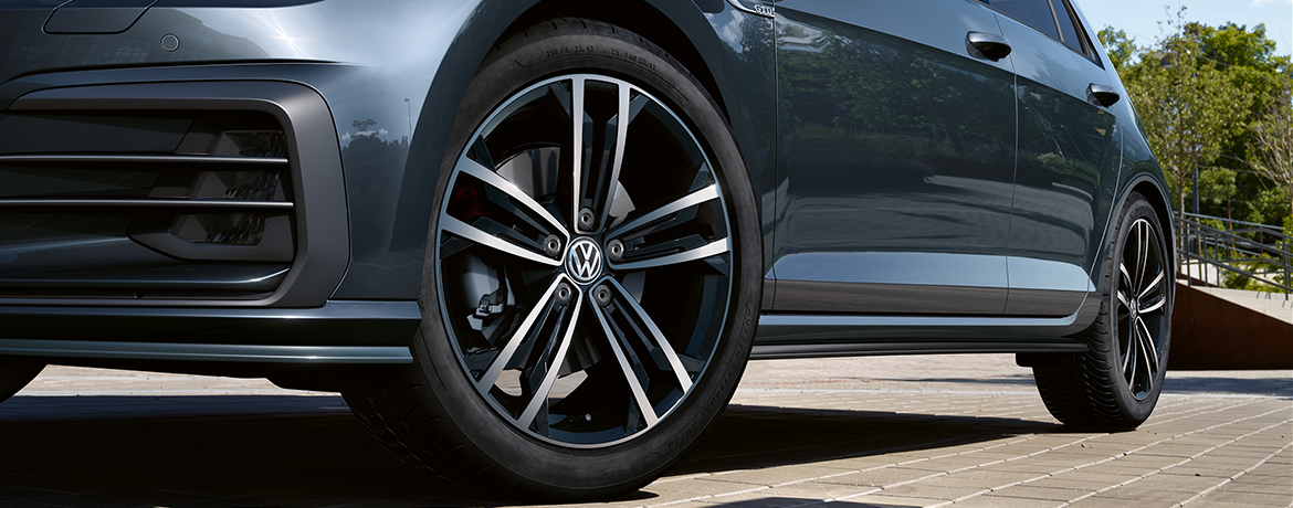 A close of of a Volkswagen, focusing on the tyres