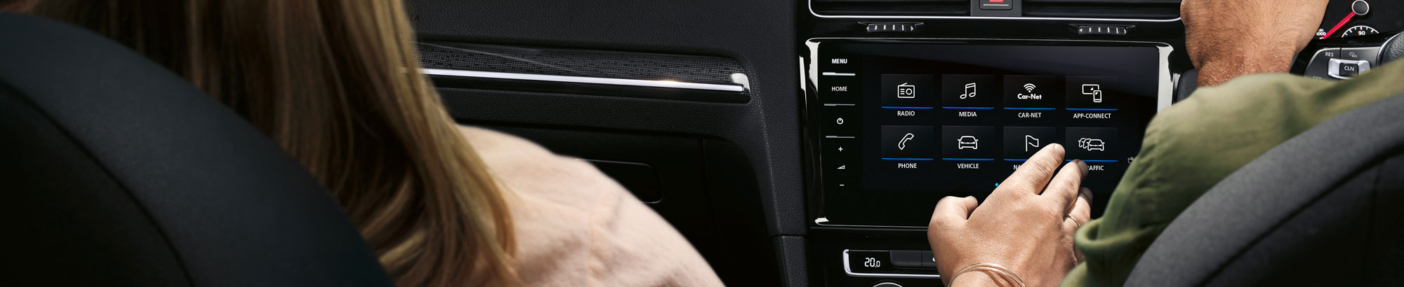 Person interacting with the Discover Pro Infotainment system